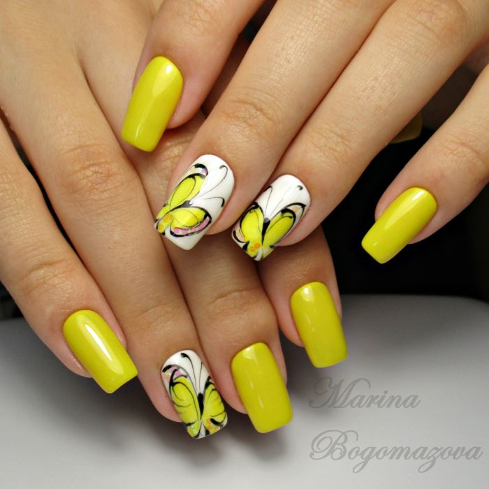 Желтый маникюр с бабочками