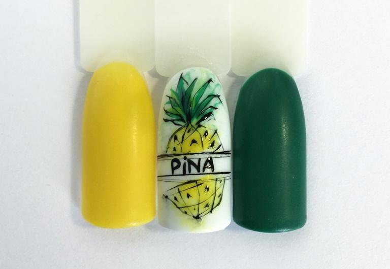 Идея маникюра на лето с ананасом